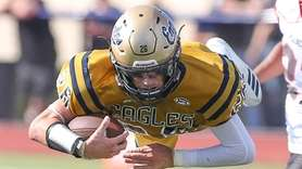 Bethpage's Matt Schneider runs the ball and gets