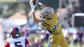 Bethpage's Christian Castles pulls in a pass in
