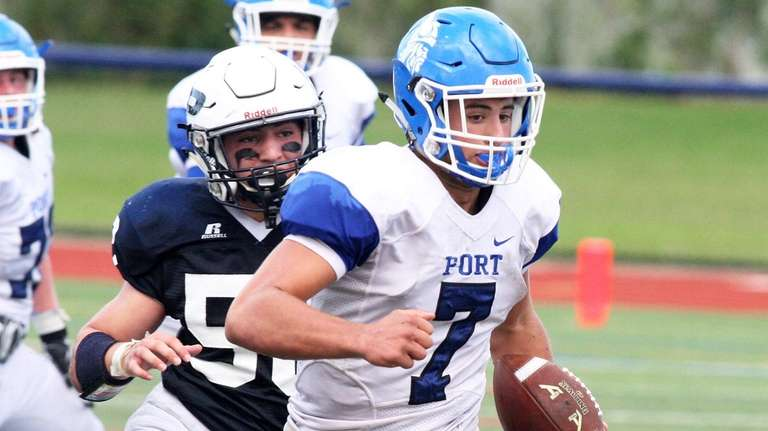 Port Washington quarterback Elliot Avidane looks for some