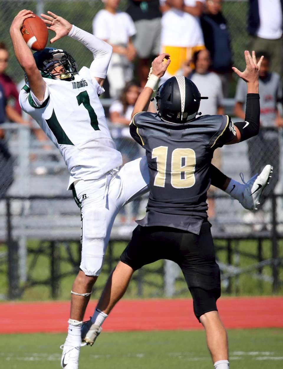 Brentwood Kenny Lazo grabs the pass over Commack