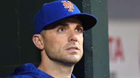 New York Mets' David Wright looks on from