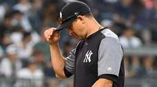 New York Yankees manager Aaron Boone walks back