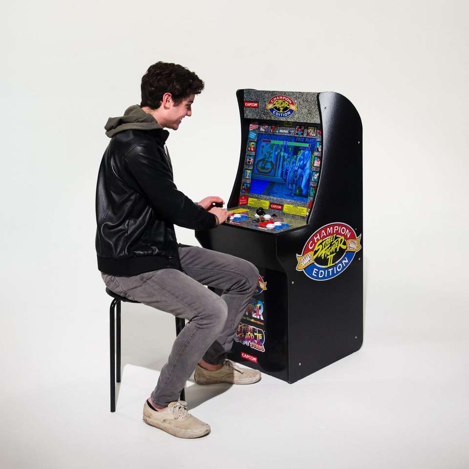 Play seated or standing, these game cabinets look