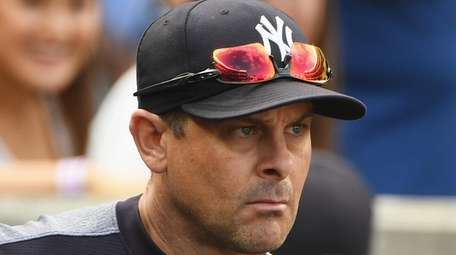 New York Yankees manager Aaron Boone looks on