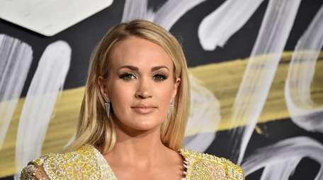 Carrie Underwood attends the 2018 CMT Music Awards