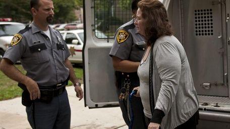 Joan Tuckruskye, 44, of Baldwin, arrives at the