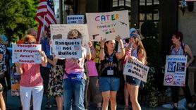 Demonstrators pledged Sunday to boycott companies that do