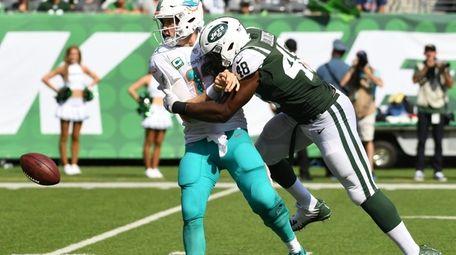 New York Jets linebacker Jordan Jenkins sacks Miami