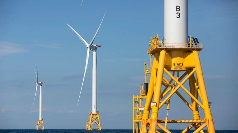 Three of Deepwater Wind's five turbines stand in