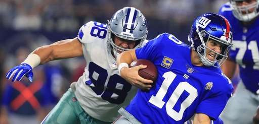 Tyrone Crawford of the Dallas Cowboys sacks Giants