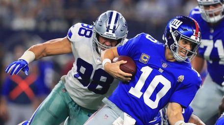 Tyrone Crawford of the Dallas Cowboys sacks Giants