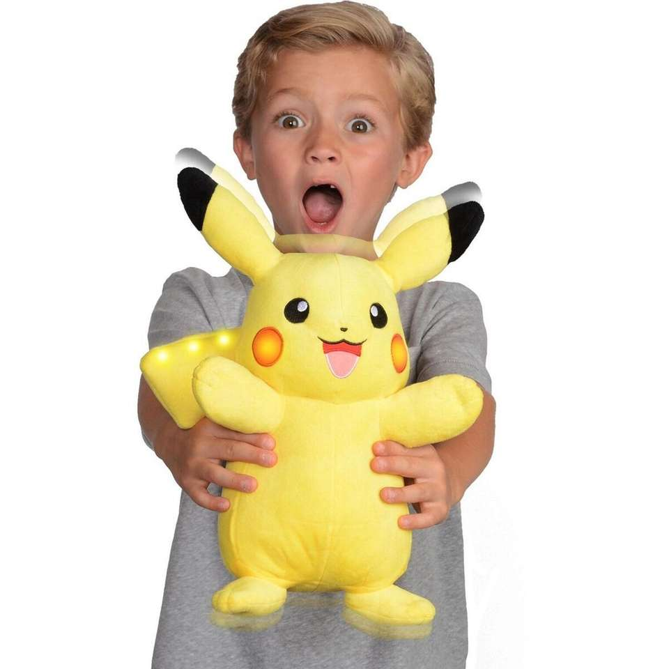 Pikachu lights up, speaks, has sound effects and
