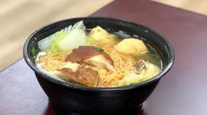 Chinese-style noodle soup with freshly roasted chicken is