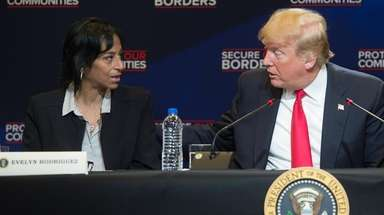 Evelyn Rodriguez with President Donald Trump during a