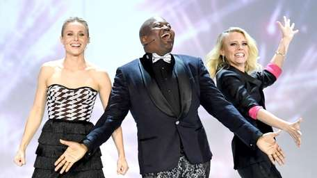 Tituss Burgess and Kate McKinnon perform onstage.