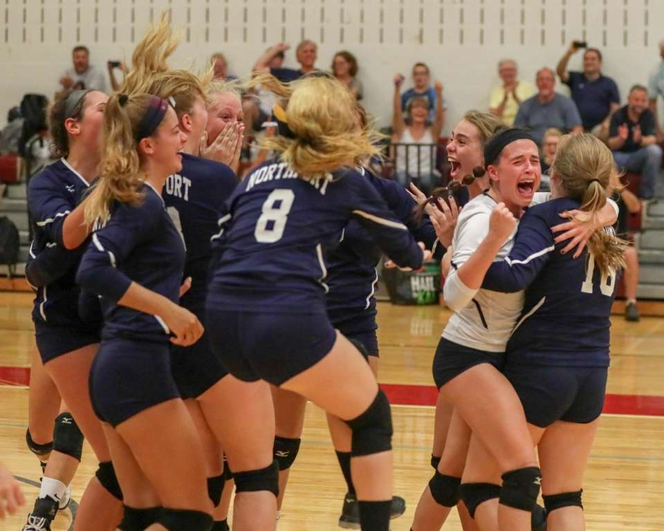 Northport players celebrate after the final point in