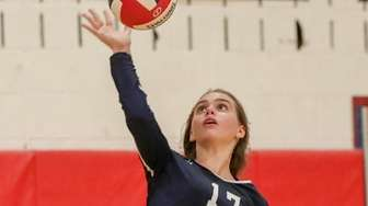 Northport's Sophie Campbell #17 serves the ball at