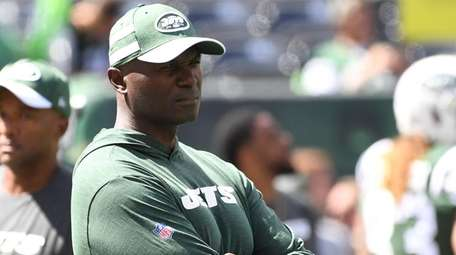 Jets head coach Todd Bowles observes warmups before