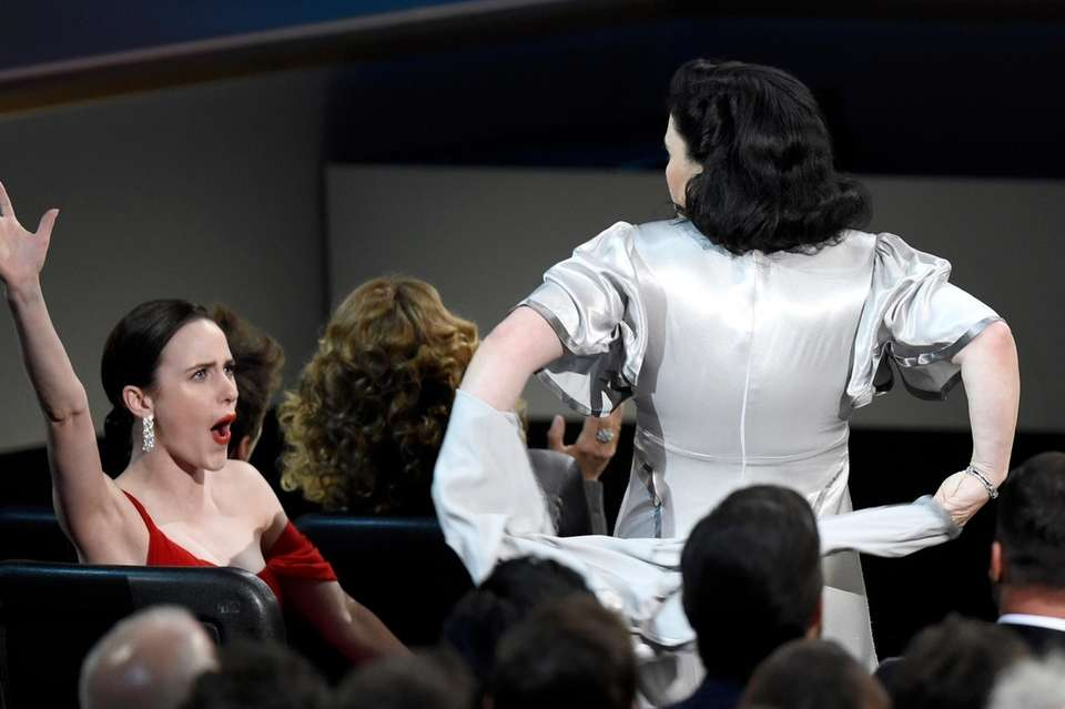 Rachel Brosnahan, left, cheers as her