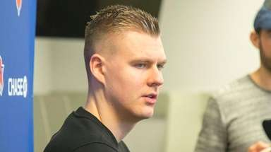 Knicks forward Kristaps Porzingis speaks with the media