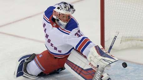 Rangers goaltender Marek Mazanec deflects the puck during