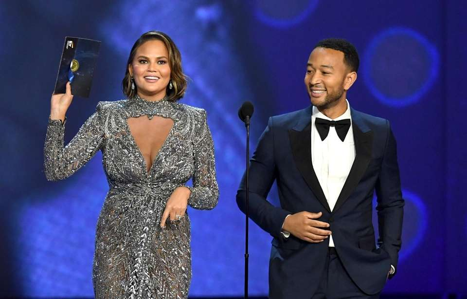 Chrissy Teigen and John Legend onstage.