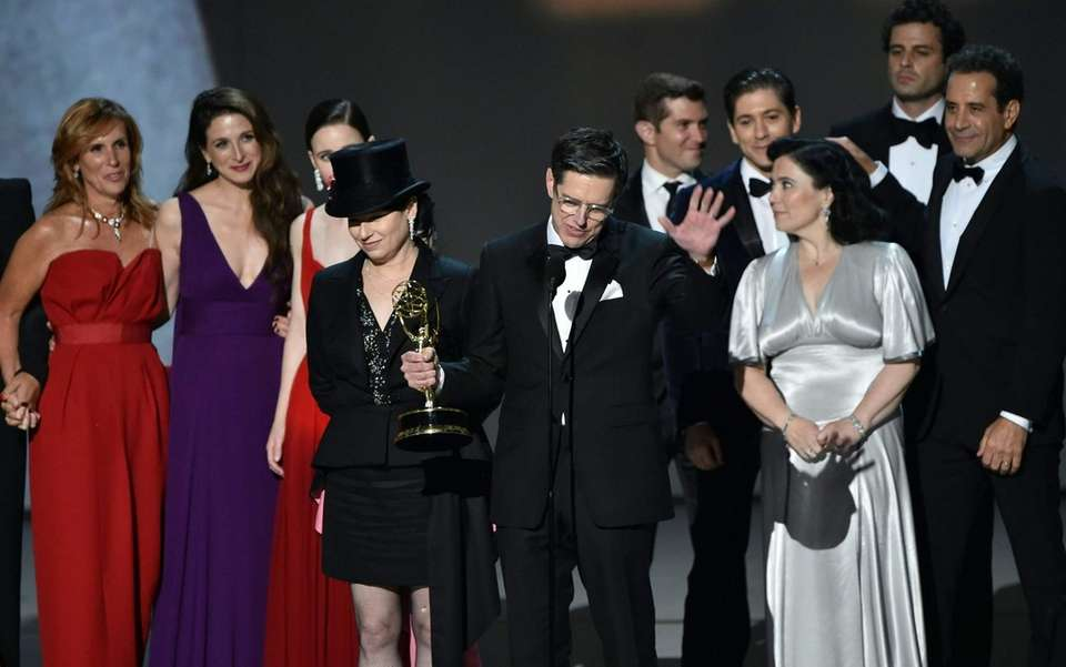 Amy Sherman-Palladino, front center left, and Daniel Palladino,