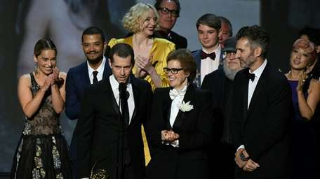 Writer-producer D.B. Weiss, center left, and the cast