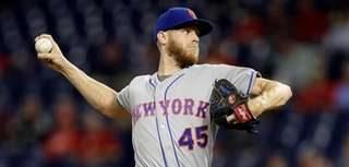 Mets pitcher Zack Wheeler delivers during a game