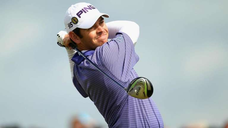 Louis Oosthuizen of South Africa hits his tee