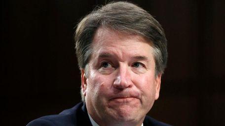 Supreme Court nominee Brett Kavanaugh reacts as he