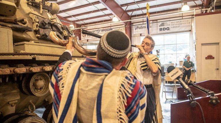 Rabbis Joel Levenson, left, and Harvey Abromowitz blow