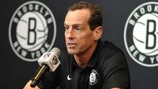 Nets coach Kenny Atkinson speaks with the media
