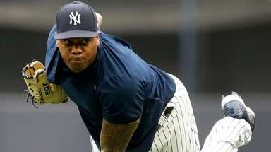 Yankees pitcher Aroldis Chapman throws on the field