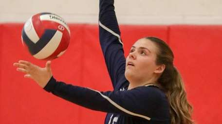 Northport's Sydnie Rohme serves the ball against Connetquot