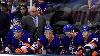 Islanders head coach Barry Trotz looks on against