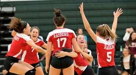 Patchogue-Medford players celebrate their fifth-set victory against Ward