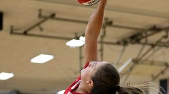 Patchogue-Medford outside hitter Kayla Martin gets the kill
