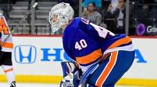 Islanders Robin Lehner reacts after allowing a second-period