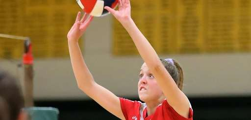 Patchogue-Medford's Caitlin Dellecave sets the ball at the