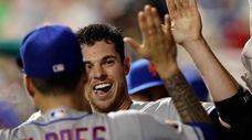 Mets pitcher Steven Matz celebrates with Wilmer Flores