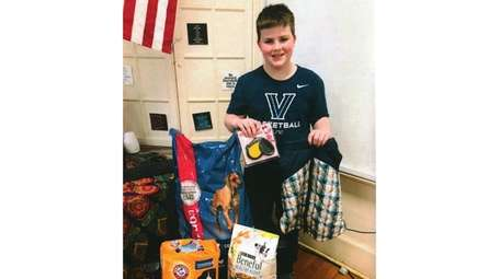 Kidsday reporter Brendan Bohn with supplies he has
