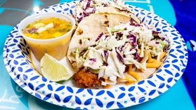 Fried flounder stars in fish tacos with slaw,