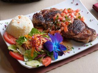 Churrasco, a grilled New York strip steak rubbed