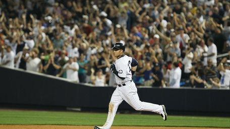 Nick Swisher of the New York Yankees rounds