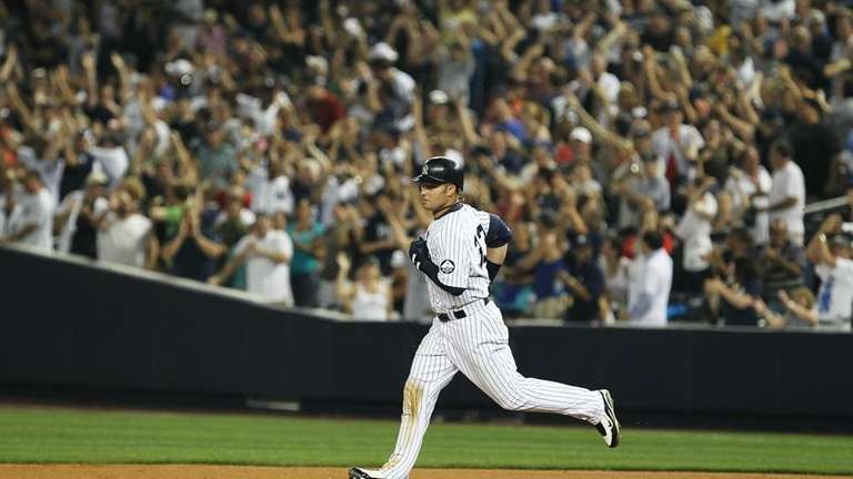 Nick Swisher of the New York Yankees rounds