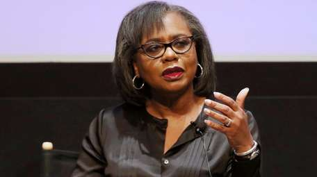 Anita Hill speaks at a discussion about sexual