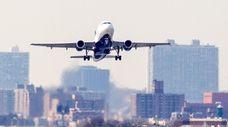 An undated photo shows a plane near LaGuardia
