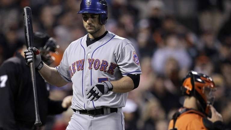 The Mets' David Wright walks to the dugout
