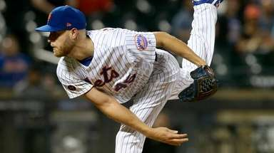 Mets pitcher Zack Wheeler delivers against the Marlins